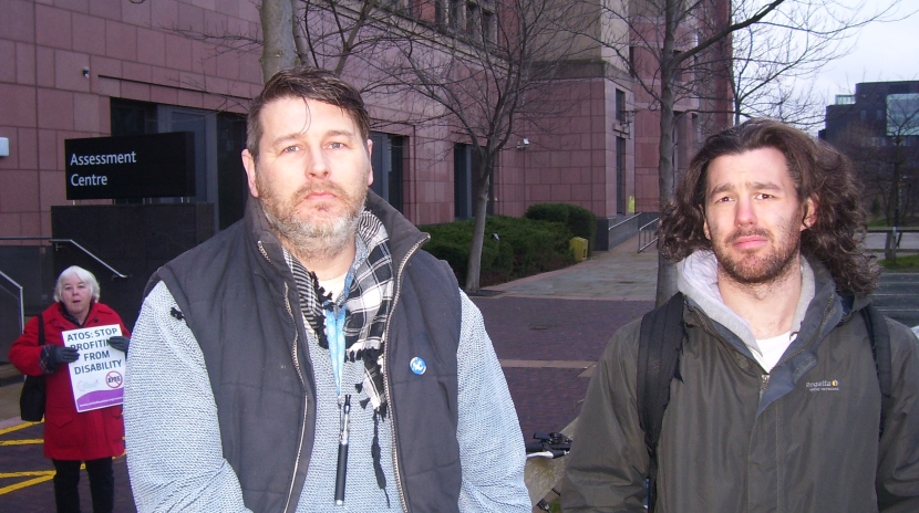 Tom Smith and Joe Salmon outside the Leeds Assessment Centre as part of the at the National ATOS Protest