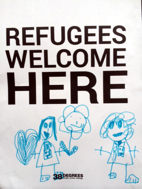 Refugees welcome here poster with a child's illustrations